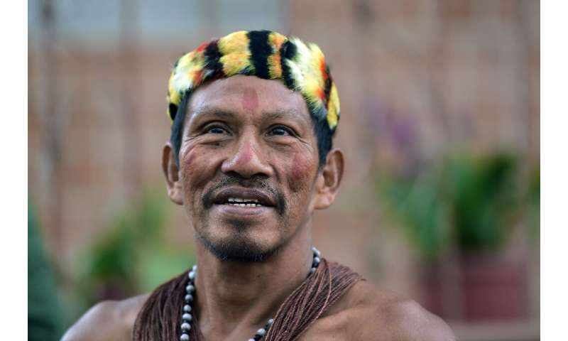 A Waorani indigenous man takes part in a march over oil exploration in his ancestral lands