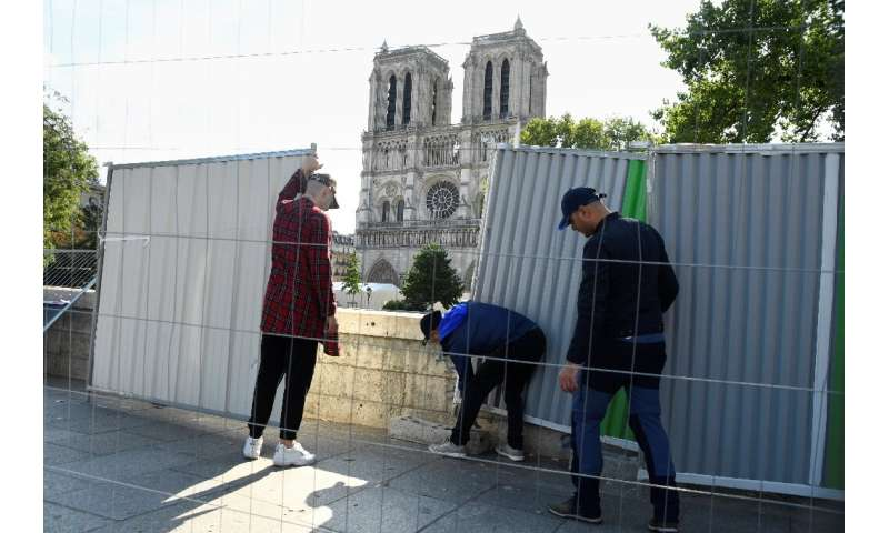 Barriers were set up as a truck delivered pipes and pumps for cleaning the esplanade in front of Paris' great medieval cathedral