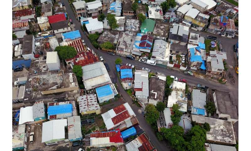 Blue tarps given out by FEMA cover several roofs two years after Hurricane Maria hit Puerto Rico.