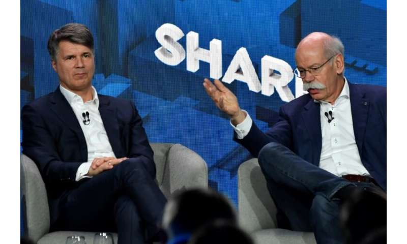 BMW CEO Harald Krueger and Daimler chief Dieter Zetsche announced the plan to combine their companies' carsharing schemes on Fri