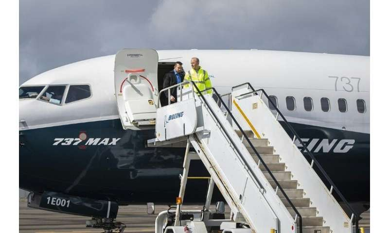 Boeing Chief Executive Dennis Muilenburg deplaning a Boeing 737 MAX after a test flight of the company's proposed fix to its ant