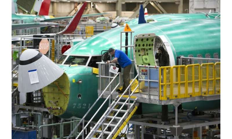 Boeing employees work on a 737 MAX jet at the company's factory in Renton, Washington—the aviation giant has unveiled a fix to t