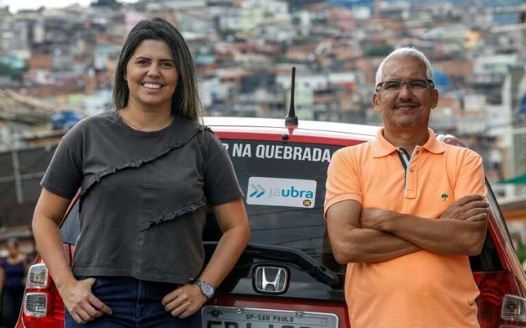 Brazilian Alvimar da Silva (R), with daughter Aline Landim, created JaUbra (Uber of slum) to serve poor Sao Paulo communities th
