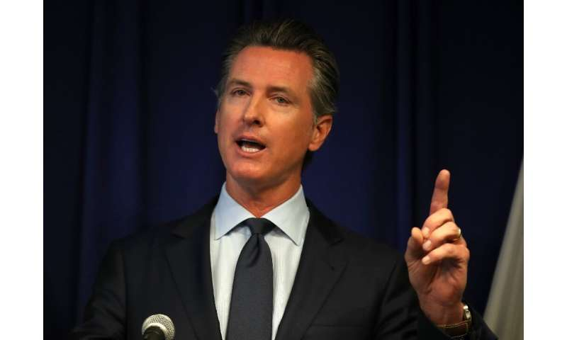 California Gov. Gavin Newsom said a law he signed requiring rideshare firms to treat drivers as employees would be a step toward