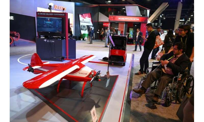 Chinese online retail and logistics company JD displays delivery robots and drones that are part of  smart retail technology bei