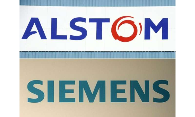 Combination of file pictures shows the logo of the French  engineering company Alstom and Germany's Siemens who are pushing for