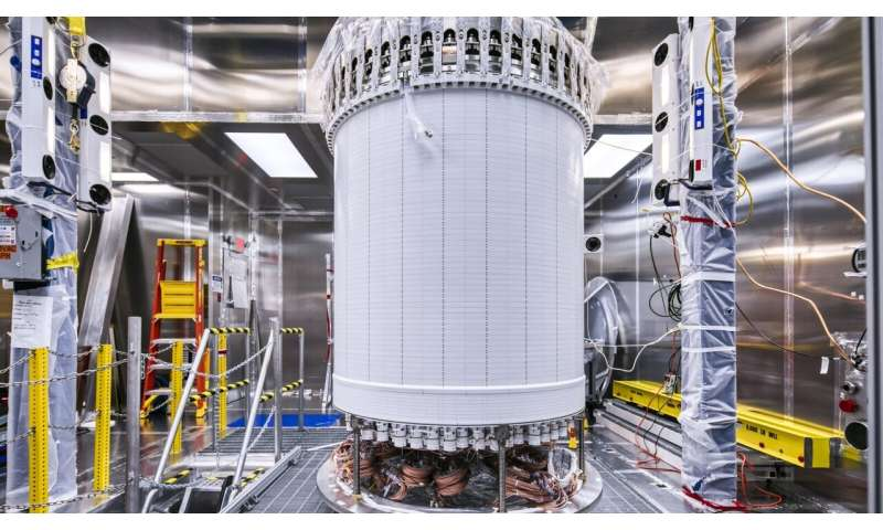Dark matter experiment's central component takes a deep dive – nearly a mile underground
