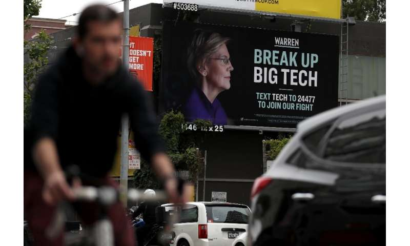 Democratic presidential hopeful Senator Elizabeth Warren, whose billboard is seen in San Francisco, has made breaking up Big Tec