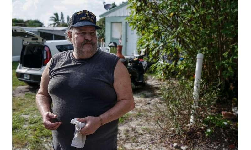 Disabled Navy veteran Joe Lewis, outside his mobile home in Jensen Beach, Florida, in an area facing mandatory evacuation orders