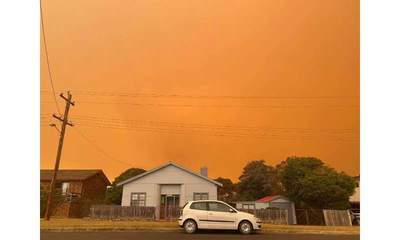 Distant bushfires light up the skies in the coastal town of Bermagui in New South Wales state