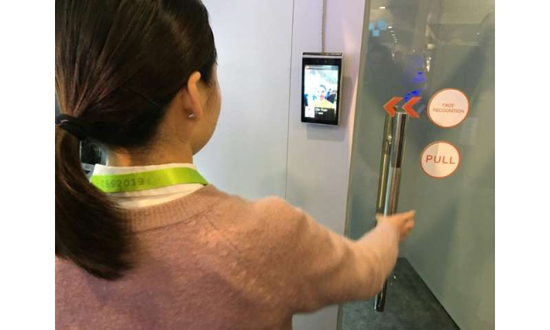 Ella Yuan of the Chinese startup Tuya shows how facial recognition can be used in a home security system to allow or deny entry,