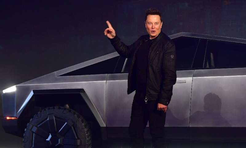 Elon Musk is seen introducing a new battery-powered Tesla truck in Hawthorne, California on November 21, 2019; his new people-mo