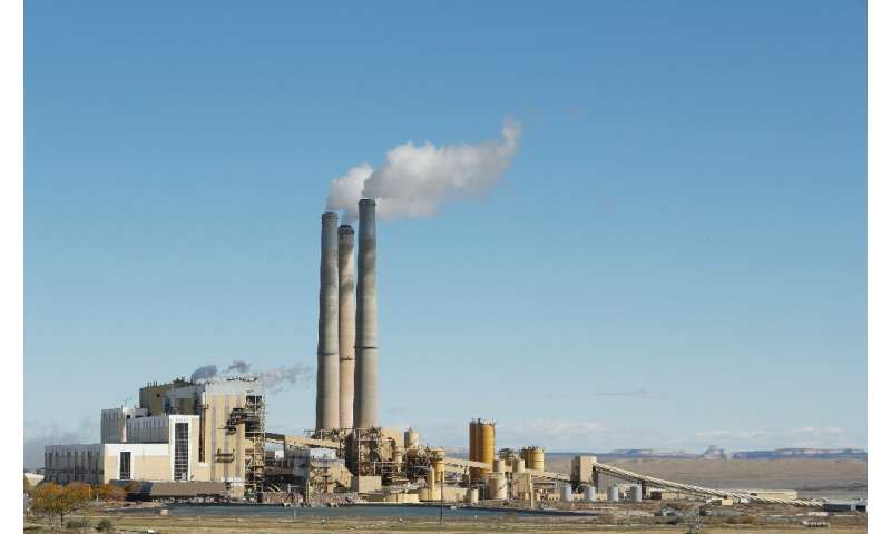 Emissions rise from the smokestacks of Pacificorp's coal-fired power plant in Castle Dale, Utah, in October 2017