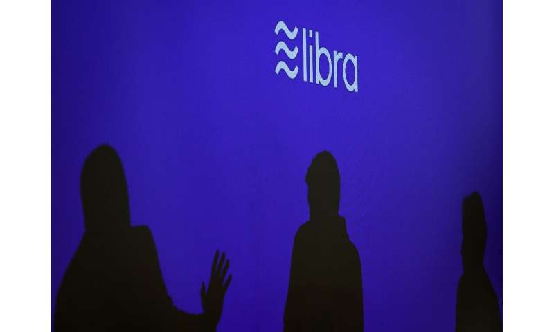 Executives involved with Facebook's proposed Libra digital currency say they will work with regulators to address their concerns