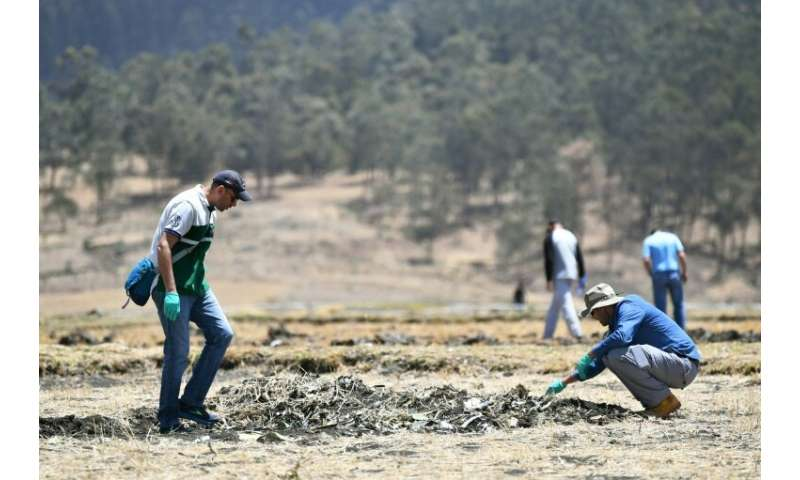 Families of victims search the site of the Ethiopian Airlines crash on March 15, 2019