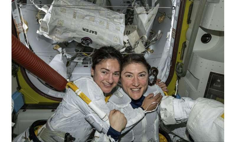 Female spacewalking duo uplifted by excitement below