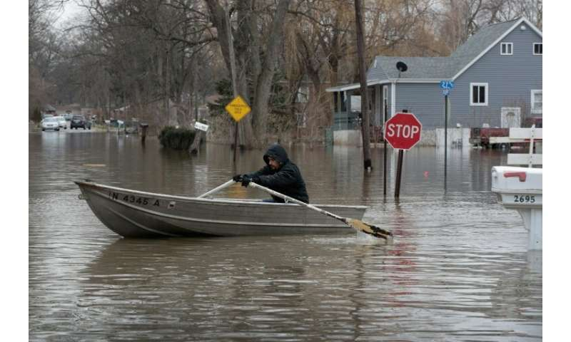 Flooding across the Midwest came a year after heavy rain deluged Indiana, pictured, Illinois, Michigan, Wisconsin and other Midw