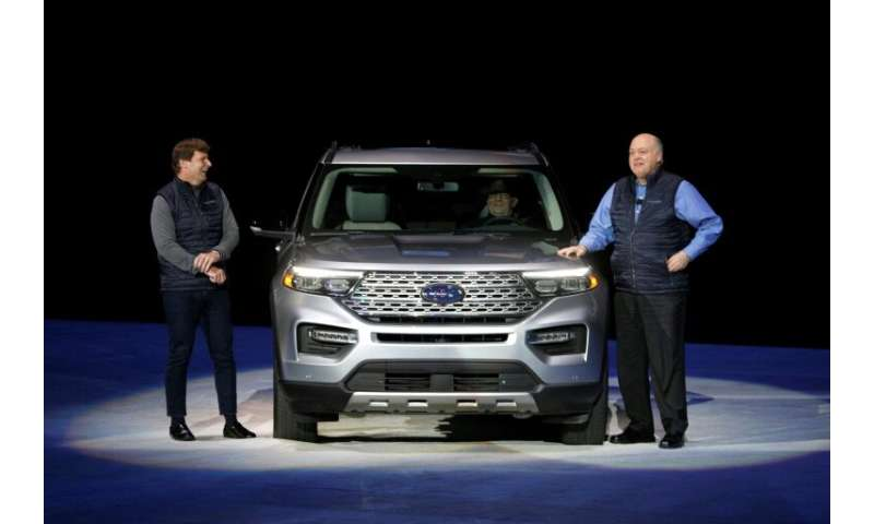 Ford CEO Jim Hackett (R) is under pressure from financial markets