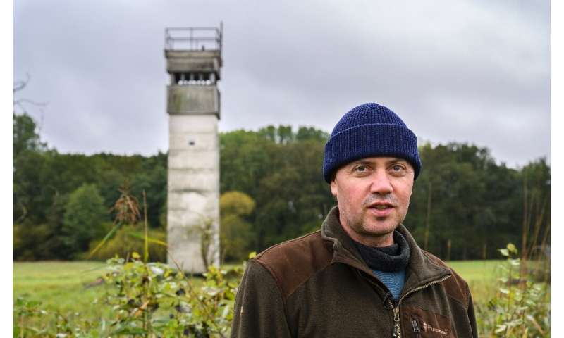 Former border guard Olaf Olejnik patrols the old border are, but this time to survey wildlife