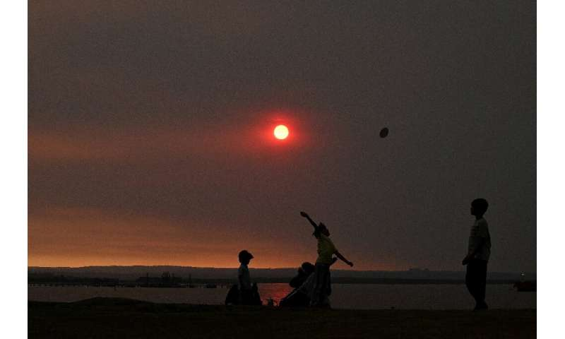 Haze hangs over Sydney as more than 50 bushfires burn across New South Wales state