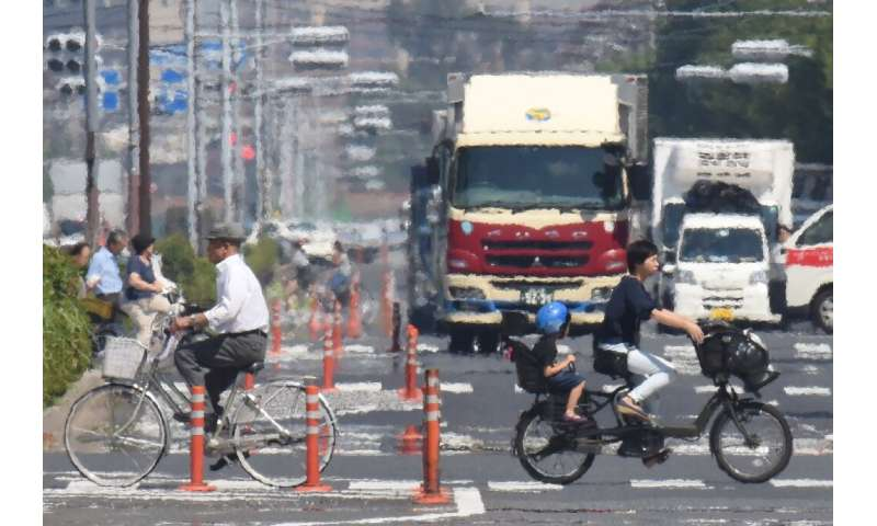 Heat haze distorts visibility during a heatwave in Tokyo - a visible phenomenon of how city infrastructure throws off heat