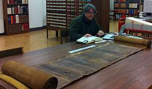 Historic scroll severed by warfare reunited through professor's quest
