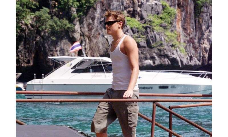 "Hollywood movie star Leonardo DiCaprio makes his way to the set in Maya Bay for the first day of filming of ""The Beach&quot"