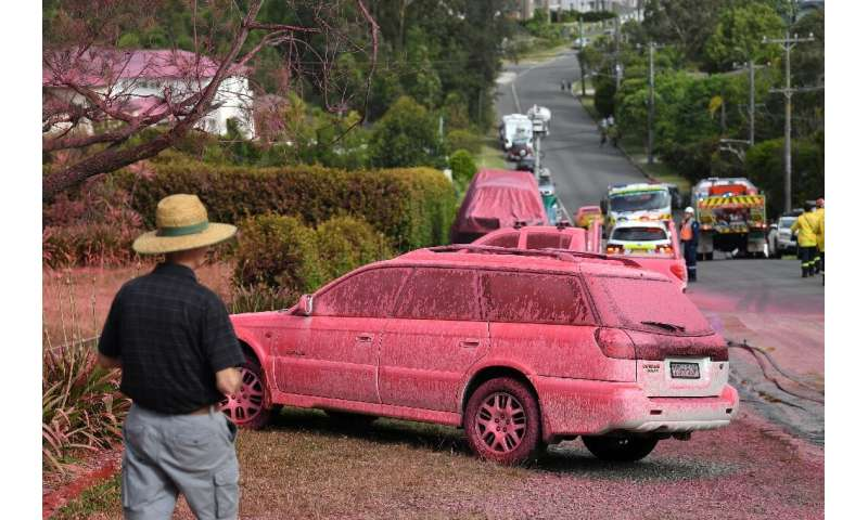 Houses and roads were caked in raspberry-red fire retardant