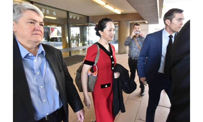 Huawei chief financial officer Meng Wanzhou (C) was arrested in 2018 during a flight stopover in Vancouver on a US warrant alleg