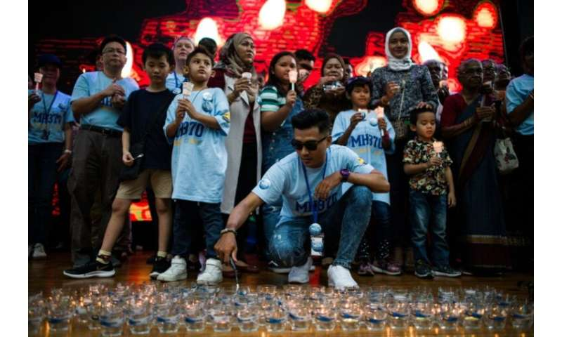 Hundreds of people, including some of the relatives of those onboard, gathered at a Kuala Lumpur shopping mall Sunday to mark th
