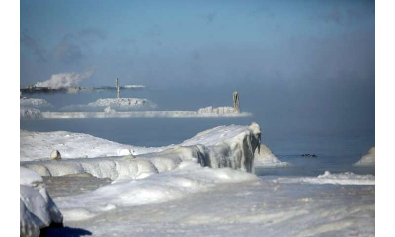 Ice covers Lake Michigan's shoreline as temperatures dropped to -20 degrees Fahrenheit (-29 degrees Celsius) on January 30, 2019