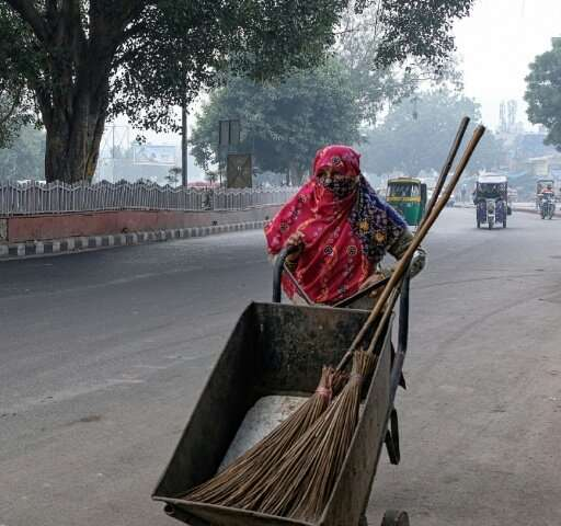 'I come at 6:30 in the morning. My eyes burn, I cough often,' says streetsweeper Lajwanti of working out side in Delhi's toxic a