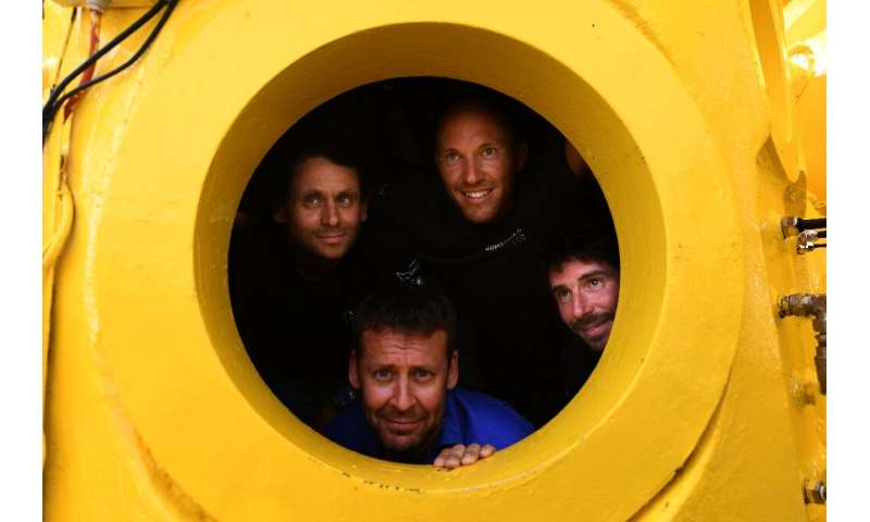 In a yellow submarine: the team of four French divers will remain inside the canary coloured capsule for an entire month
