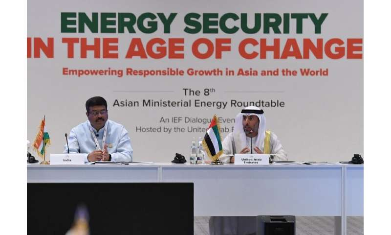 Indian Oil Minister Dharmendra Pradhan (L) listens as the United Arab Emirates Energy Minister Suheil al-Mazrouei (R ) addreses