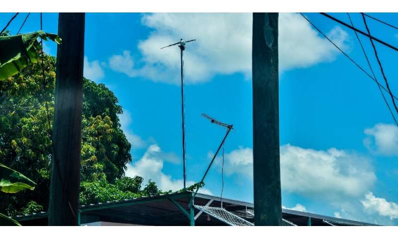 In Havana, residents install antennas on the roofs of their homes to pick up the state WiFi signal that is only available in pub