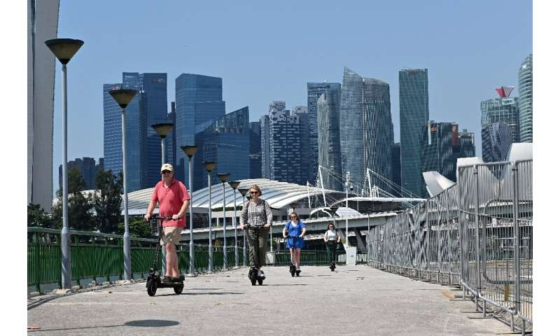 In Singapore, only the 85,000 registered e-scooters with a licence plate are allowed on the city's bike paths, with offenders fa