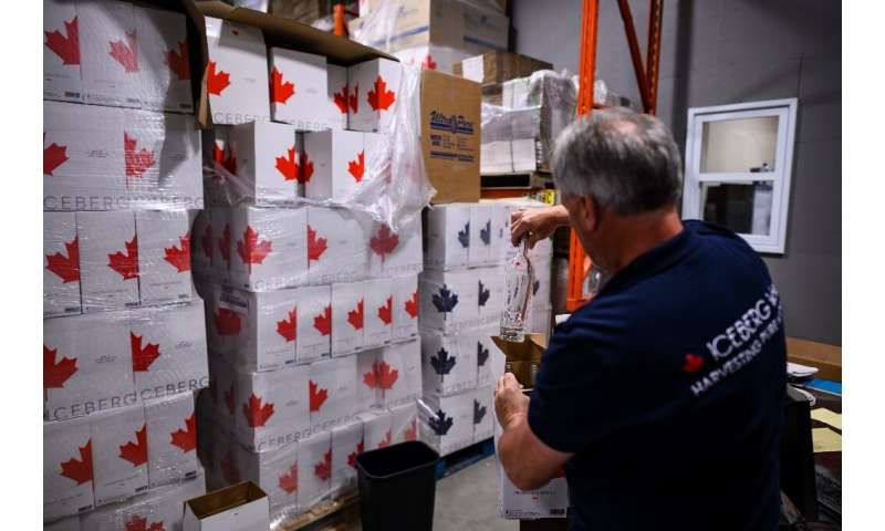 Kerry Chaulk, manager of Dyna Pro, which bottles iceberg water, packages a bottle in his factory in Lewisporte, Canada—his busin