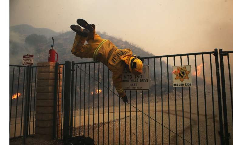 LA County firefighters battled through the night as the fast-moving Tick fire threatened some 10,000 structures