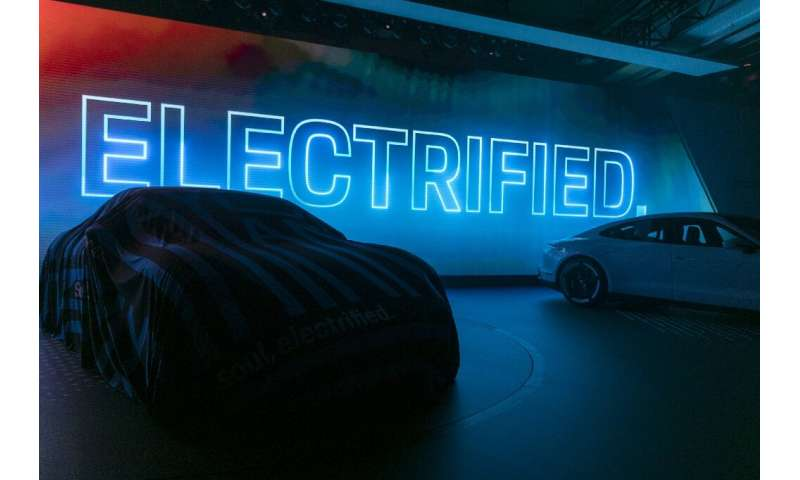 LOS ANGELES, CA - NOVEMBER 20: The Porsche Taycan 4S electric car is unveiled during its world premier at AutoMobility LA on Nov