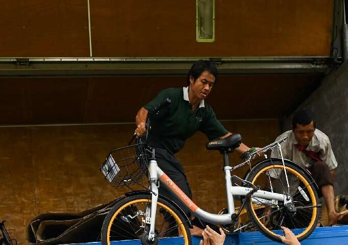 Mandalay entrepreneur Mike Than Tun Win bought up cycles from bike-sharing companies who had pulled out of Singapore and Malaysi