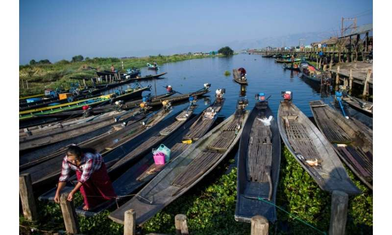 Many visitors criss-cross the lake on small wooden boats to visit stilted villages of the Intha ethnic minority