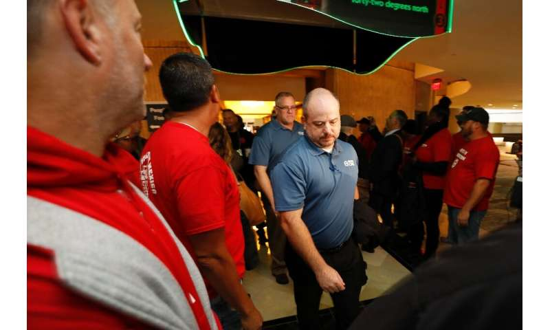 Members attending the UAW GM Council Meeting walk through a gauntlet of GM employees from the shuttered Lordstown Assembly as th