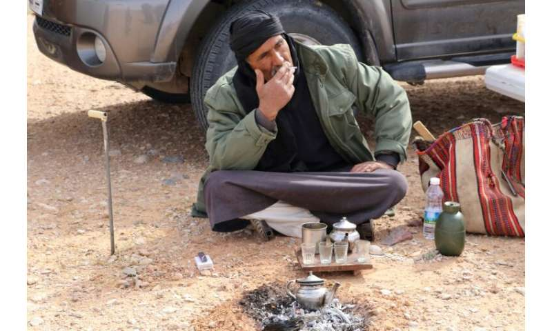 Milad Mohamad, a truffle hunter, at his desert camp site, says he harvests the white truffle as a hobby and each year before spr