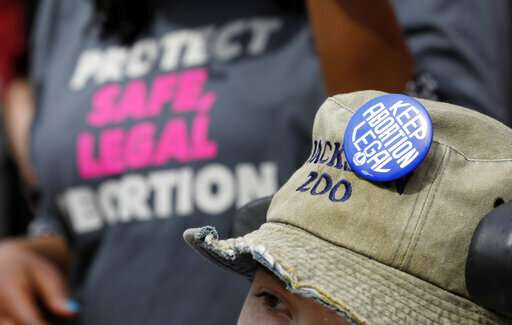 Mississippi governor signs 'heartbeat' abortion law
