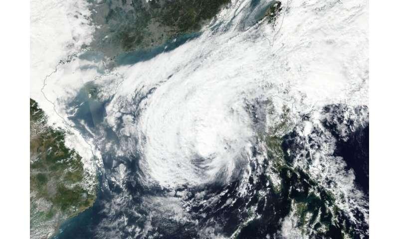 NASA finds an elongated Phanfone now a tropical storm