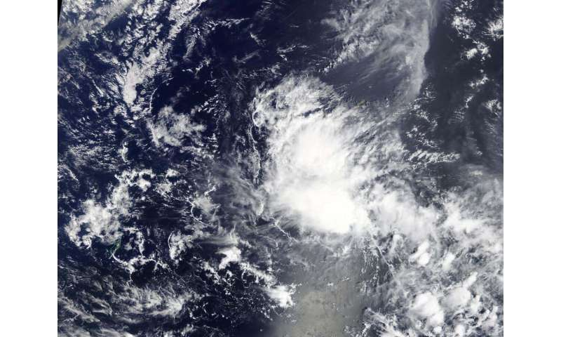 NASA sees development of Tropical Depression 03W near Yap