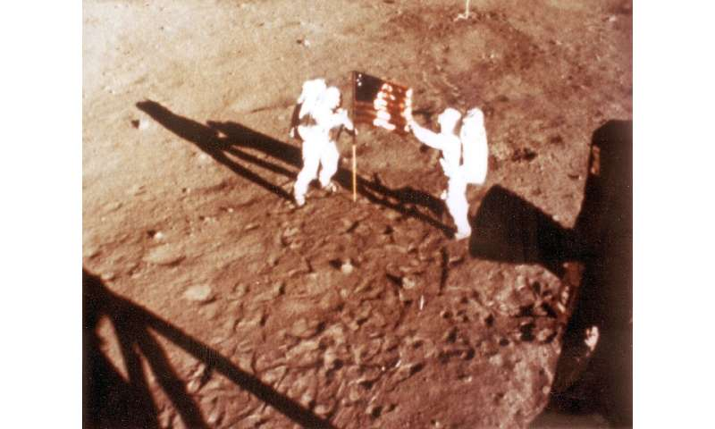 Neil Armstrong and Buzz Aldrin stand on the Moon on July 20, 1969
