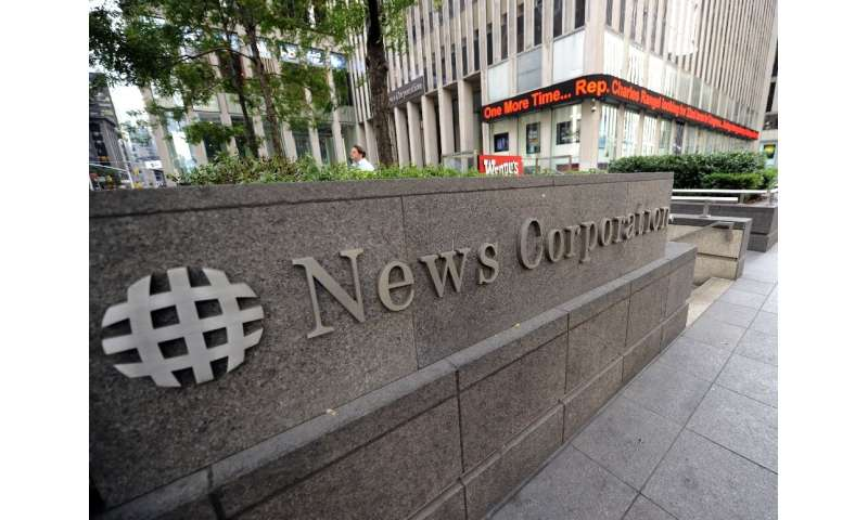 News Corp posted a net profit of $23 million in the third quarter compared to an exceptional loss of more than $1 billion last y