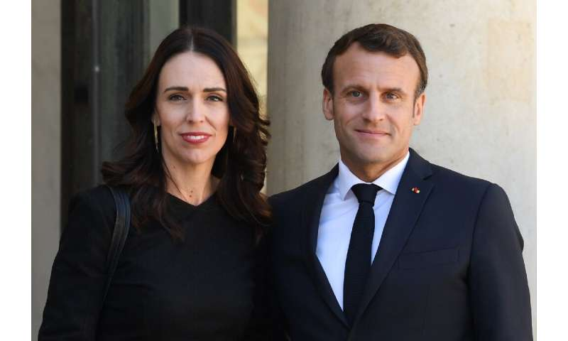 New Zealand's Prime Minister Jacinda Ardern, left, was welcomed by French President Emmanuel Macron at the Elysee Palace in Pari