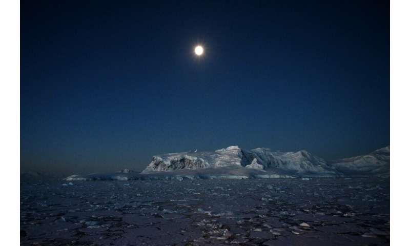 Night view of glaciers at Chiriguano bay in the South Shetland Islands, Antarctica